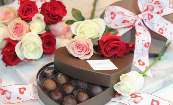 2014's perfect Valentines gift.  A sixteen piece box of hand-crafted truffles and a dozen roses.